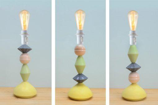 Equilibrista lamp with interchangeable colored ceramic pieces.